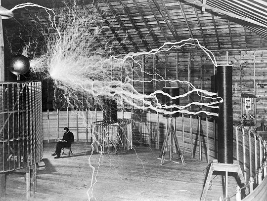 Nikola_Tesla,_with_his_equipment_EDIT